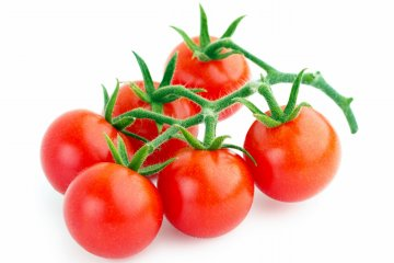 Bunch of cherry tomatoes isolated on white background