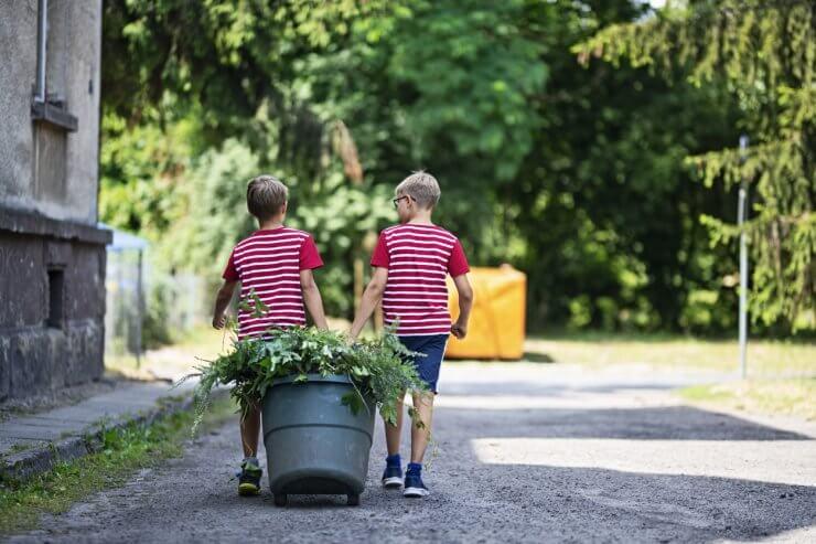 kids helping clean up garden