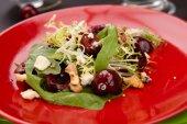 Cherry, quinoa, and arugula salad with vinaigrette