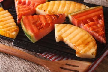 Grilled fruit ready for dressing with melon vinaigrette